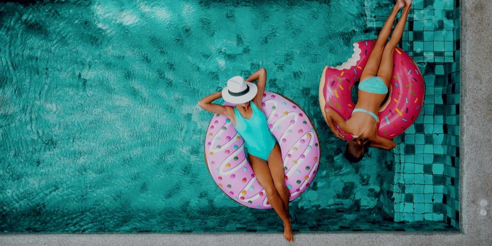 Two girls swimming in a pool