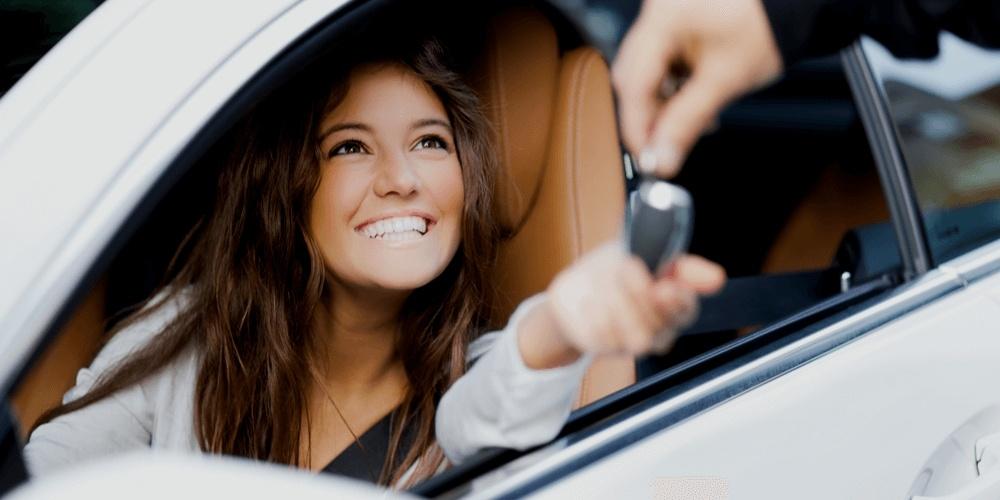 Happy woman getting a car key