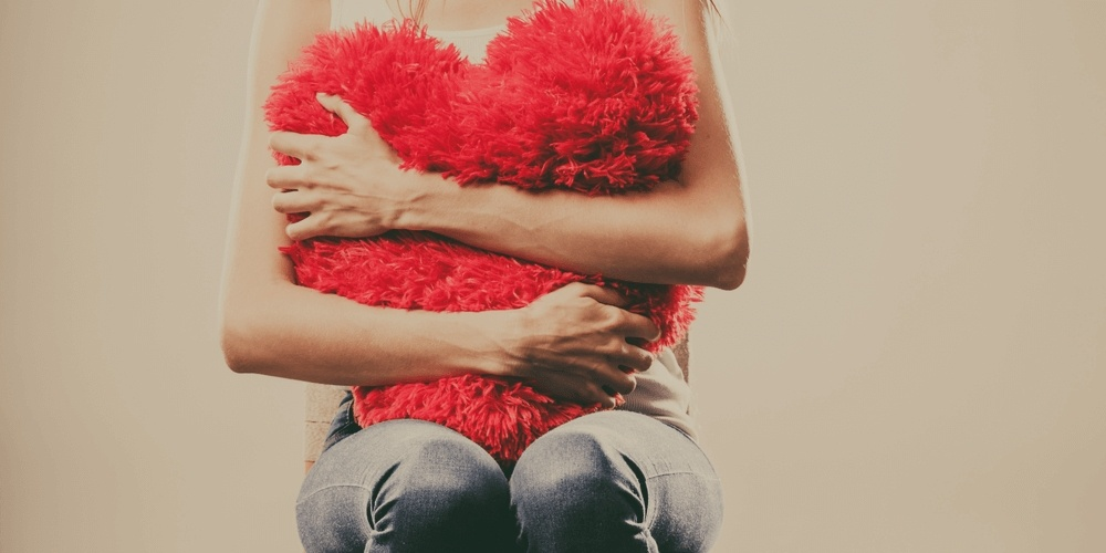 Girl embracing a red heart