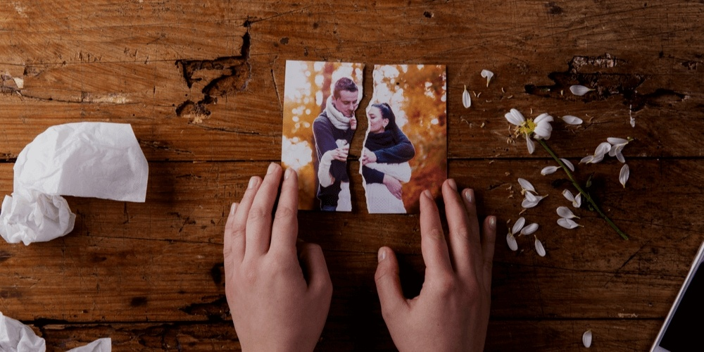 Tearing up a picture with a hppy couple