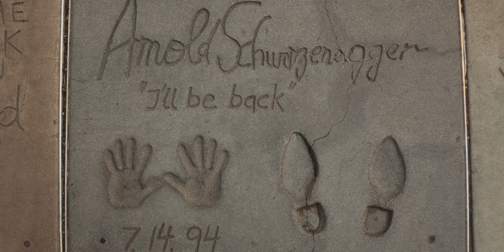 """Arnold Schwarzenegger's handprints and footprints at the Grauman's Chinese Theatre, with the """"I'll be back"""" catchphrase"""