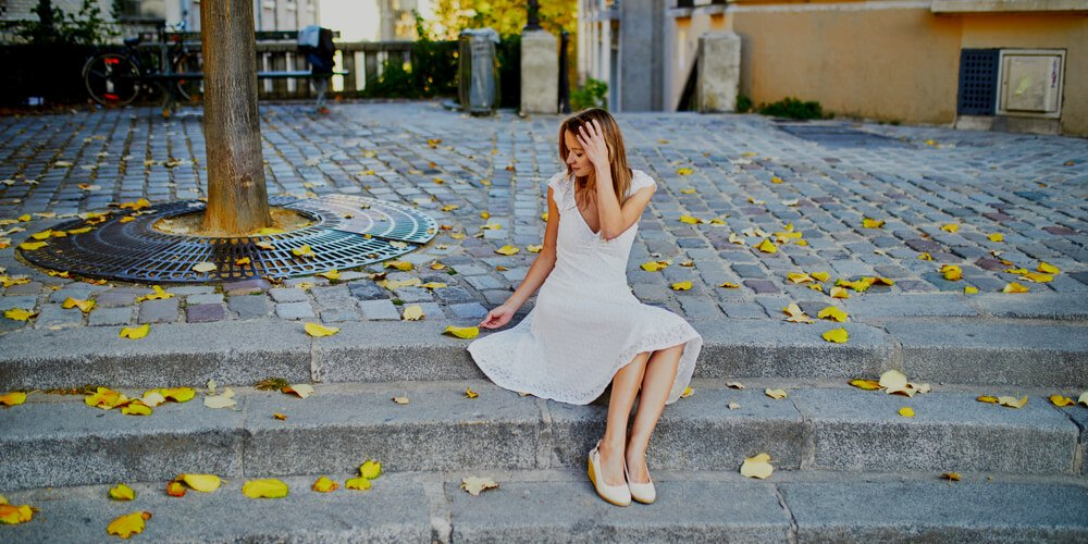 Girl in a white dress in September
