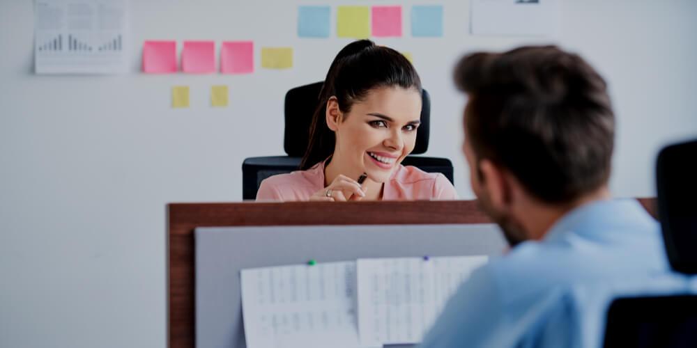 Couple flirting at work