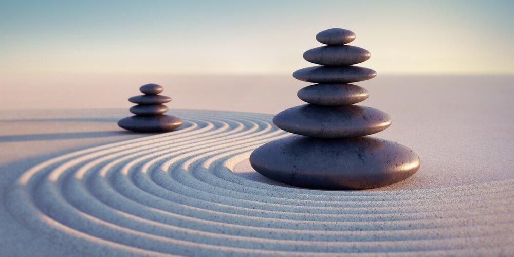 Zen and stones on sand