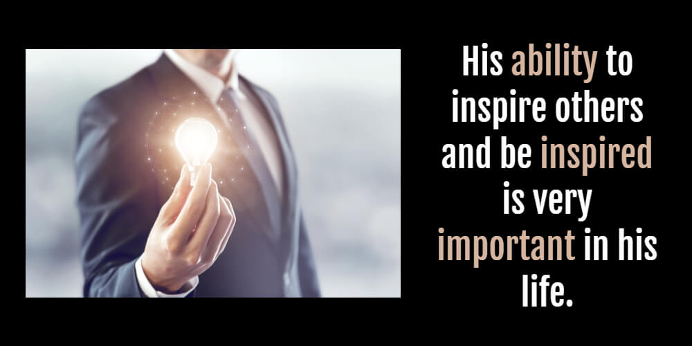 man in a suit holding a lightbulb