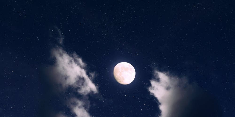 A blue moon happens when there are two full moons in one month, a rare but beautiful occurrence.