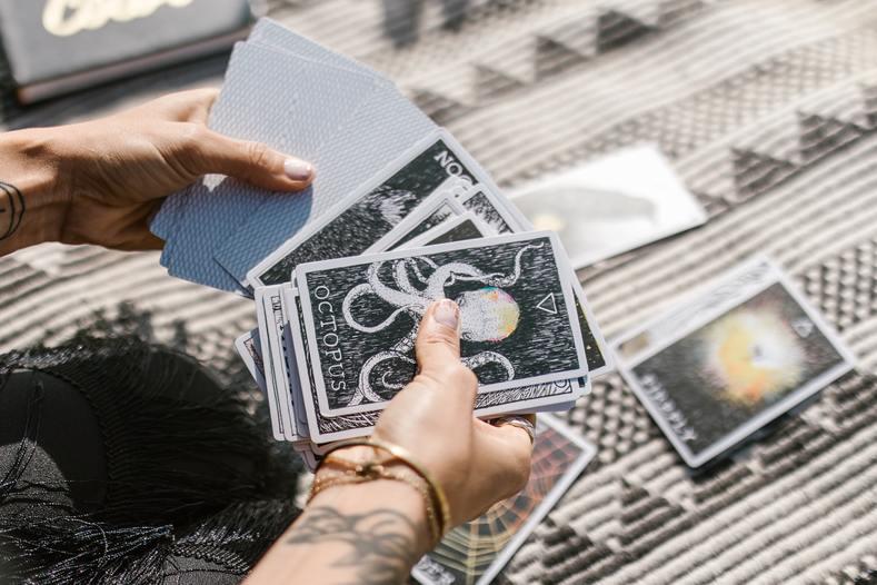 woman shuffling taro cards