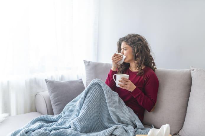 woman suffers in flu season