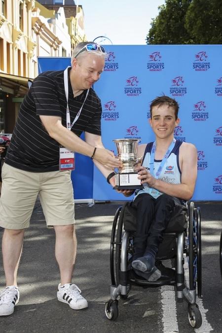 Cormac receiving trophy