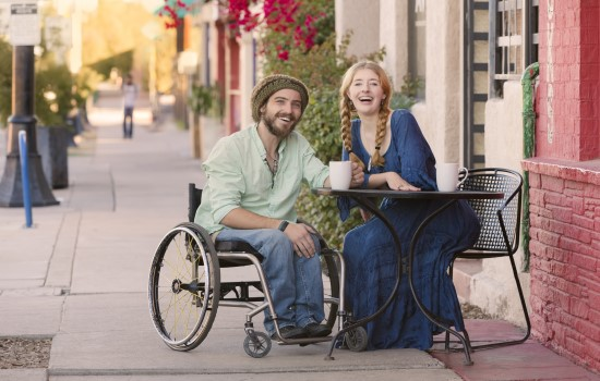 Man in wheelchair and woman smiling