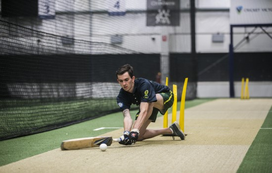 Young man playing blind cricket