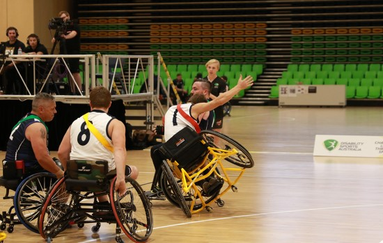 Girl playing Wheelchair Aussie Rules