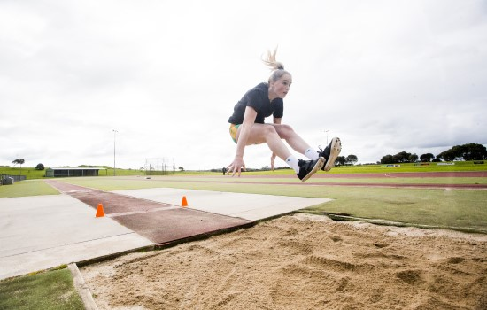 Caytlyn Sharp mid air jump