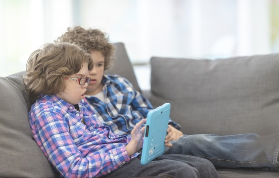 Two boys using assistive technology
