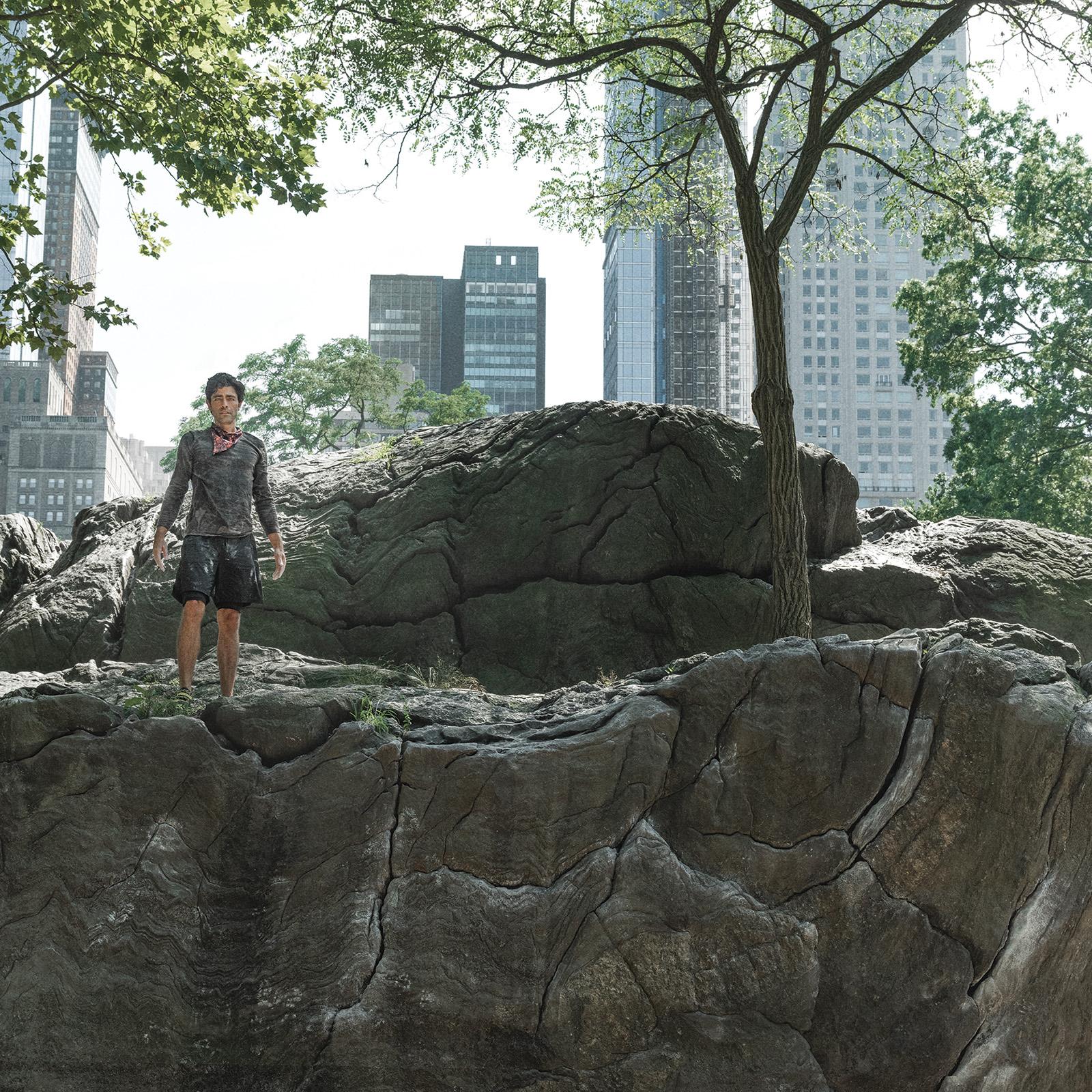 Adrian Grenier standing on a rock