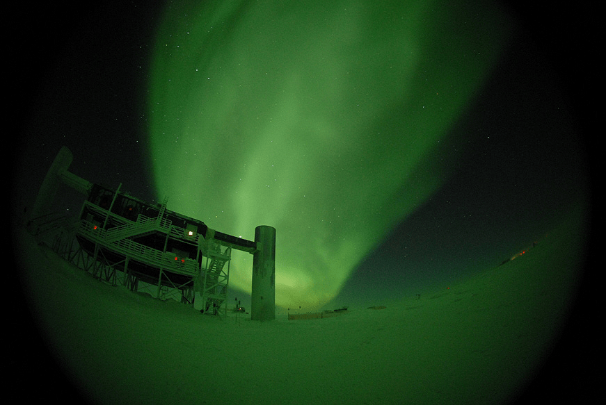 Green auroras in fisheye view of IceCube Lab
