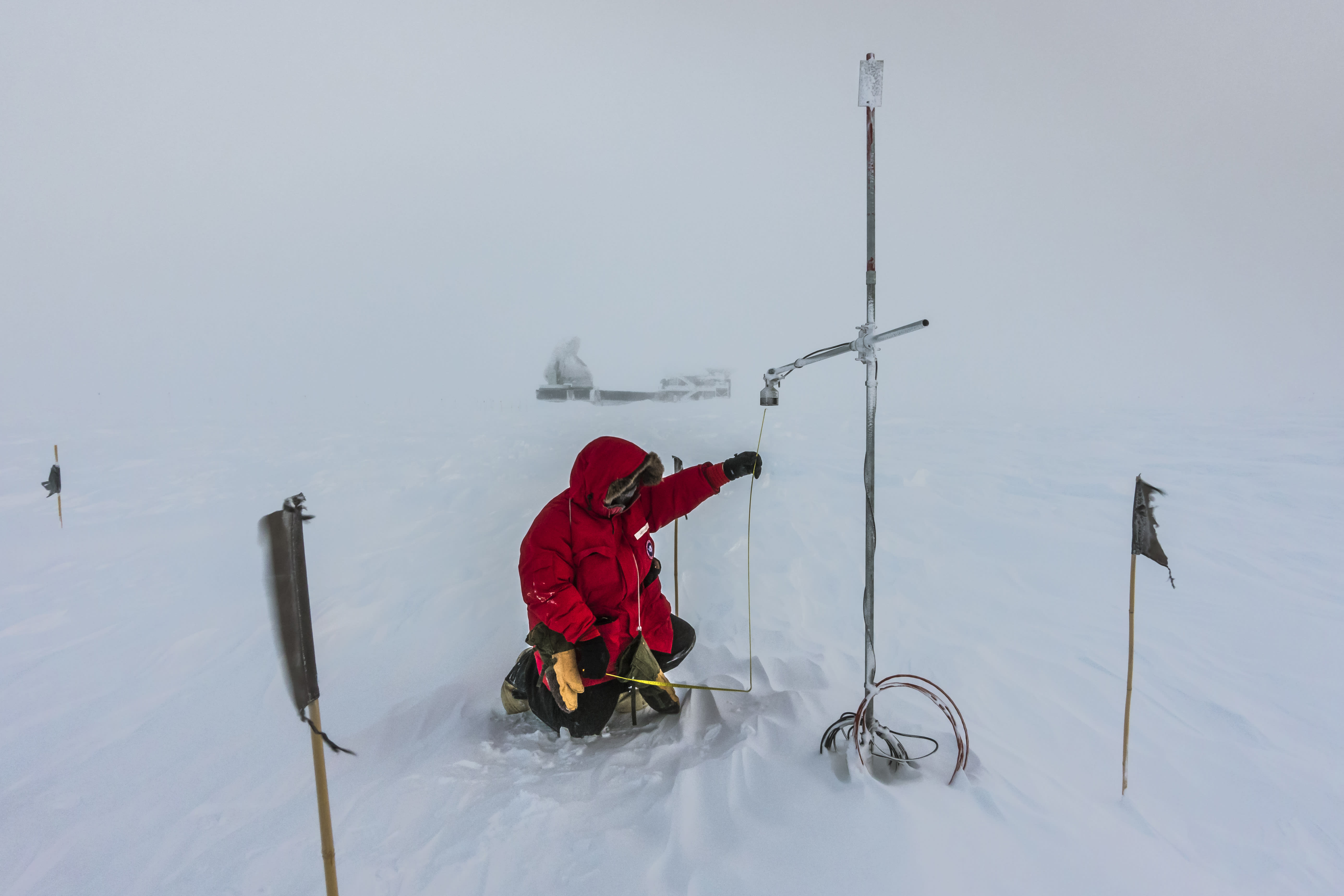 Taking snow measurements at the South Pole.