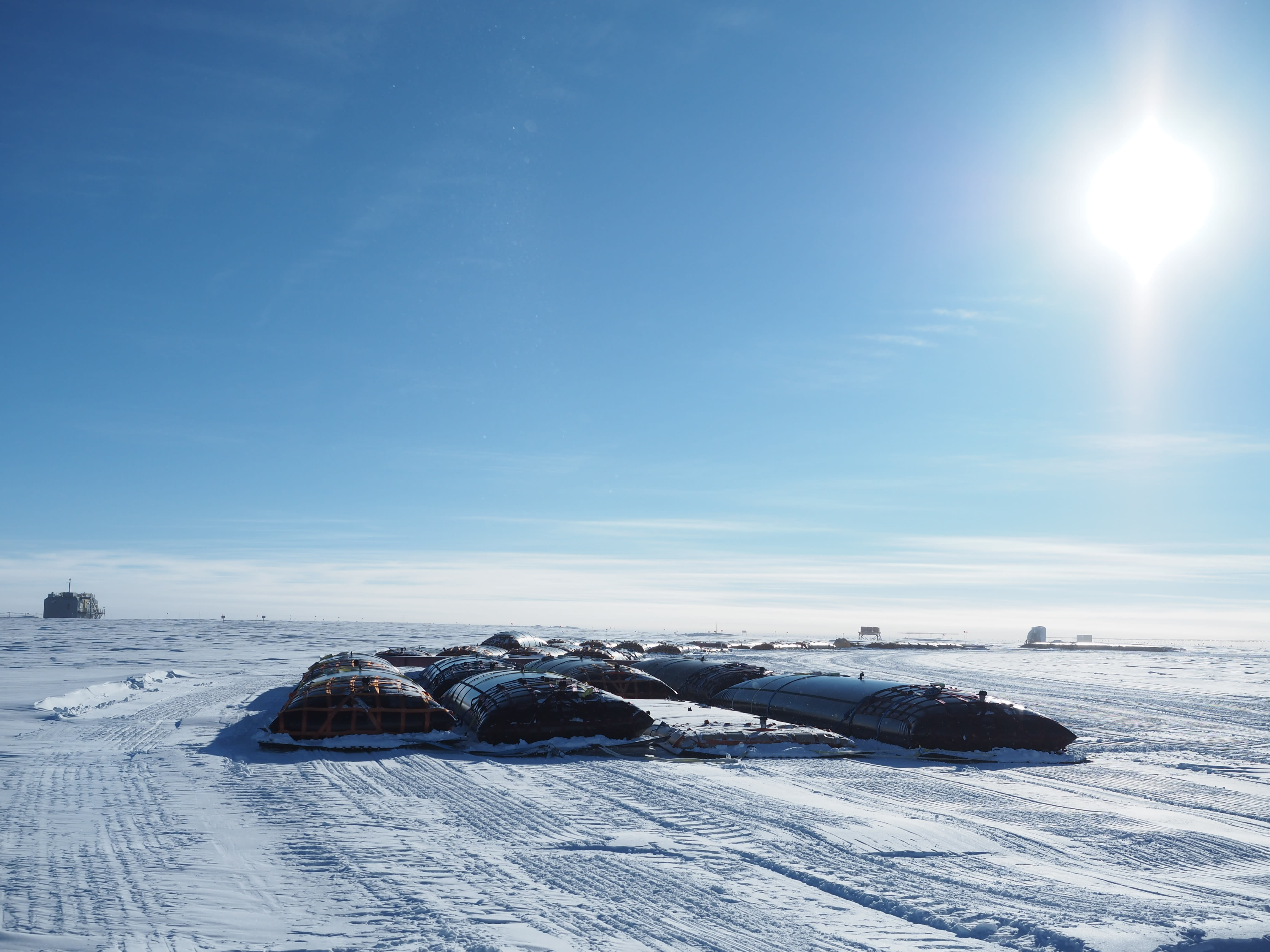 Large fuel bladders parked on the ice at the South Pole.]