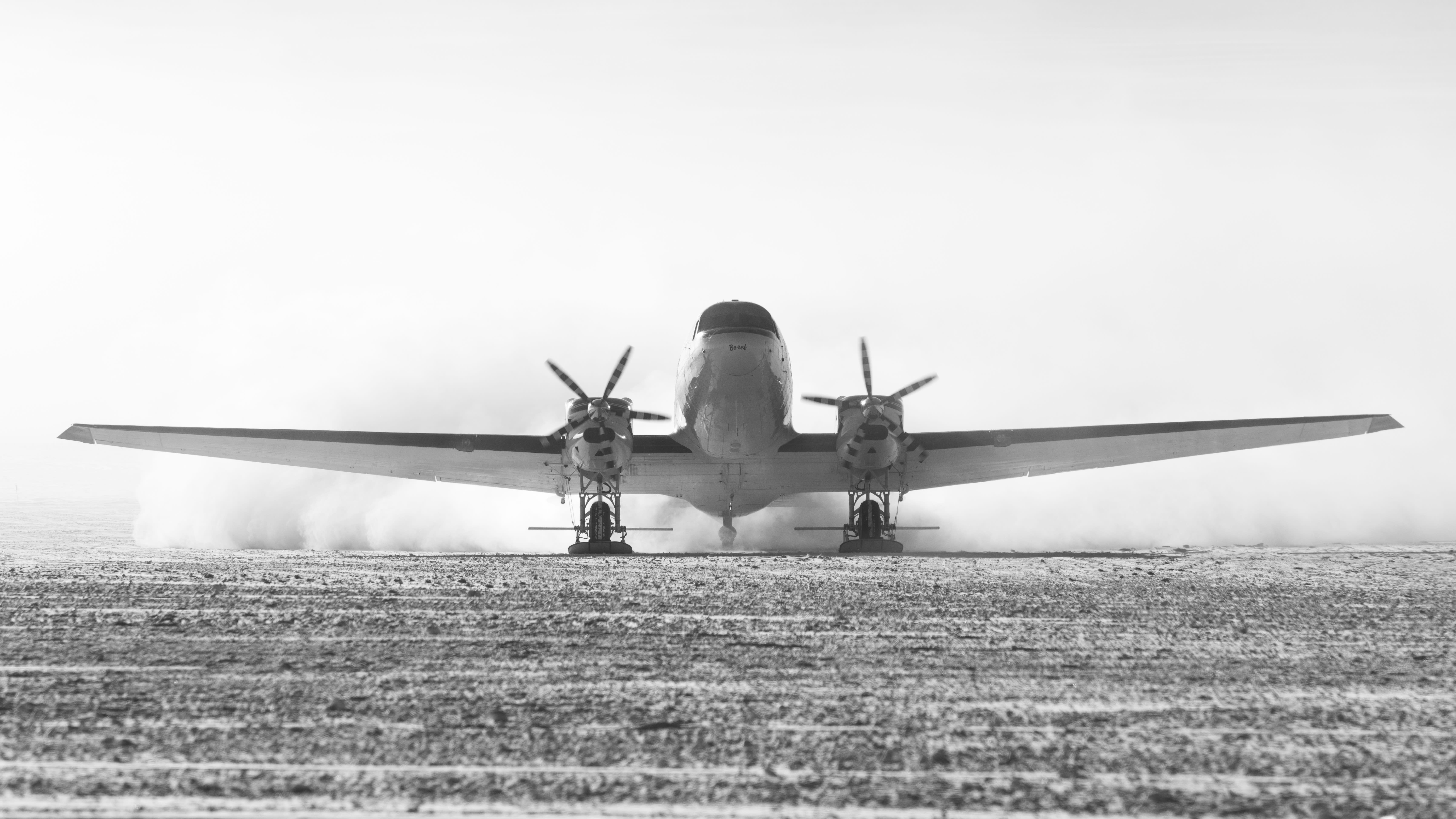 Black and white image showing head-on view of plane landing at South Pole.