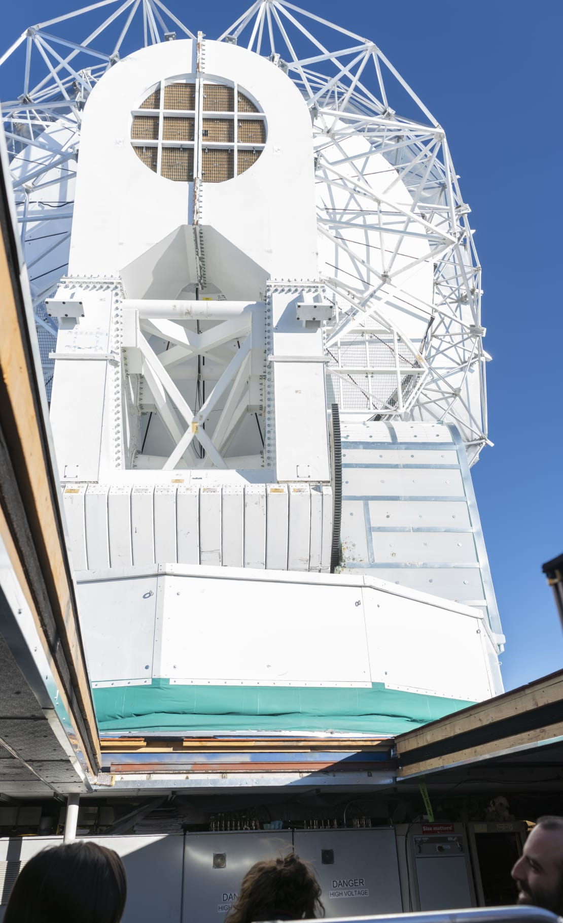 View of South Pole Telescope from below through opened roof.