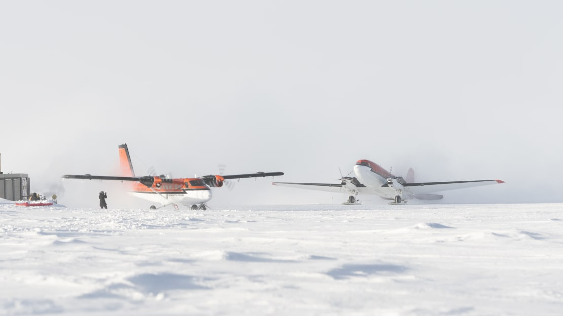 Two planes on the ground at the same time at the South Pole.