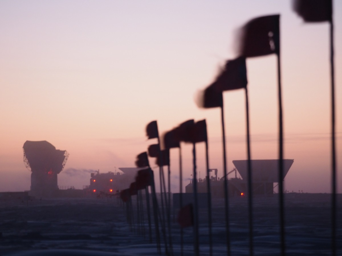 Dark sector flag line with pinkish sky at twilight.
