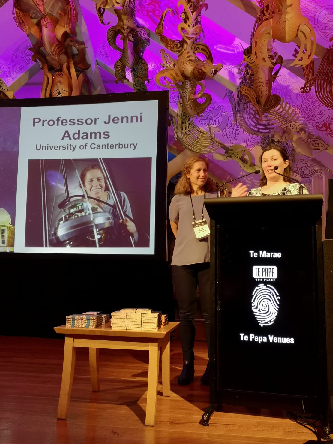 New Zealand Institute of Physics Dr Natalie Plank presents University of Canterbury Physics Professor Jenni Adams (left) with the 2021 Dan Walls medal at a ceremony in Wellington.