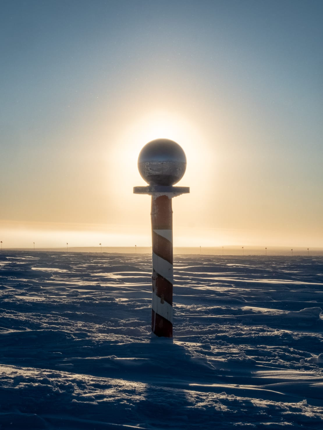 Ceremonial pole marker backlit by the rising sun.