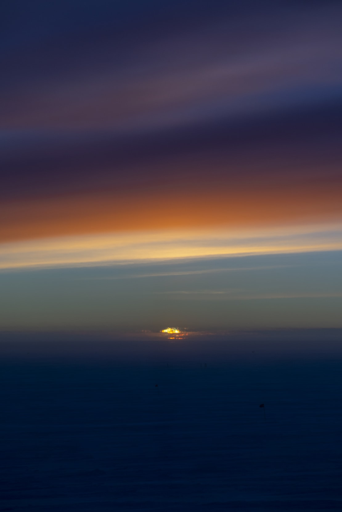 Strong dark colors in sky at sunset at the South Pole.