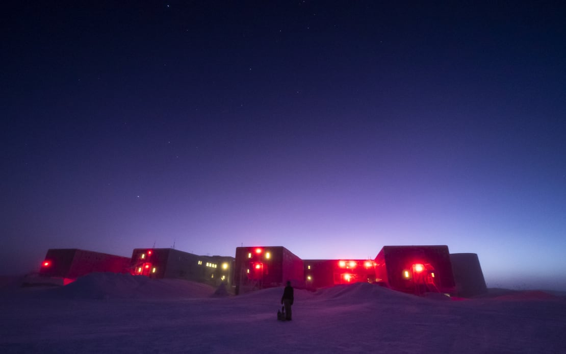 South Pole station with brightening sky at twilight.