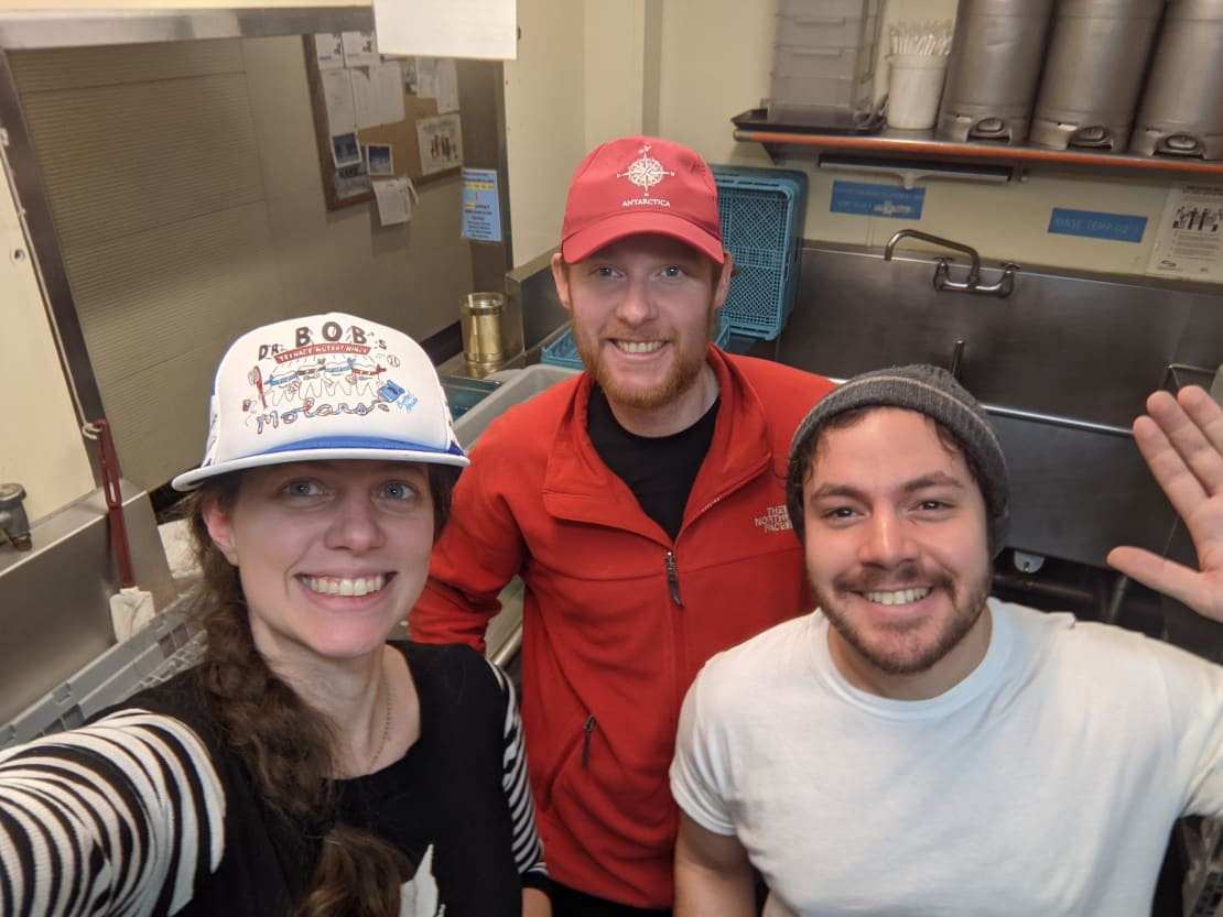 Group of three selfie in the kitchen's dishpit.