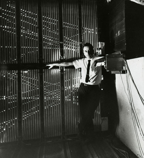 Melvin Schwartz with the 10-ton spark chamber, showing a multiple exposure of cosmic-ray muon tracks.