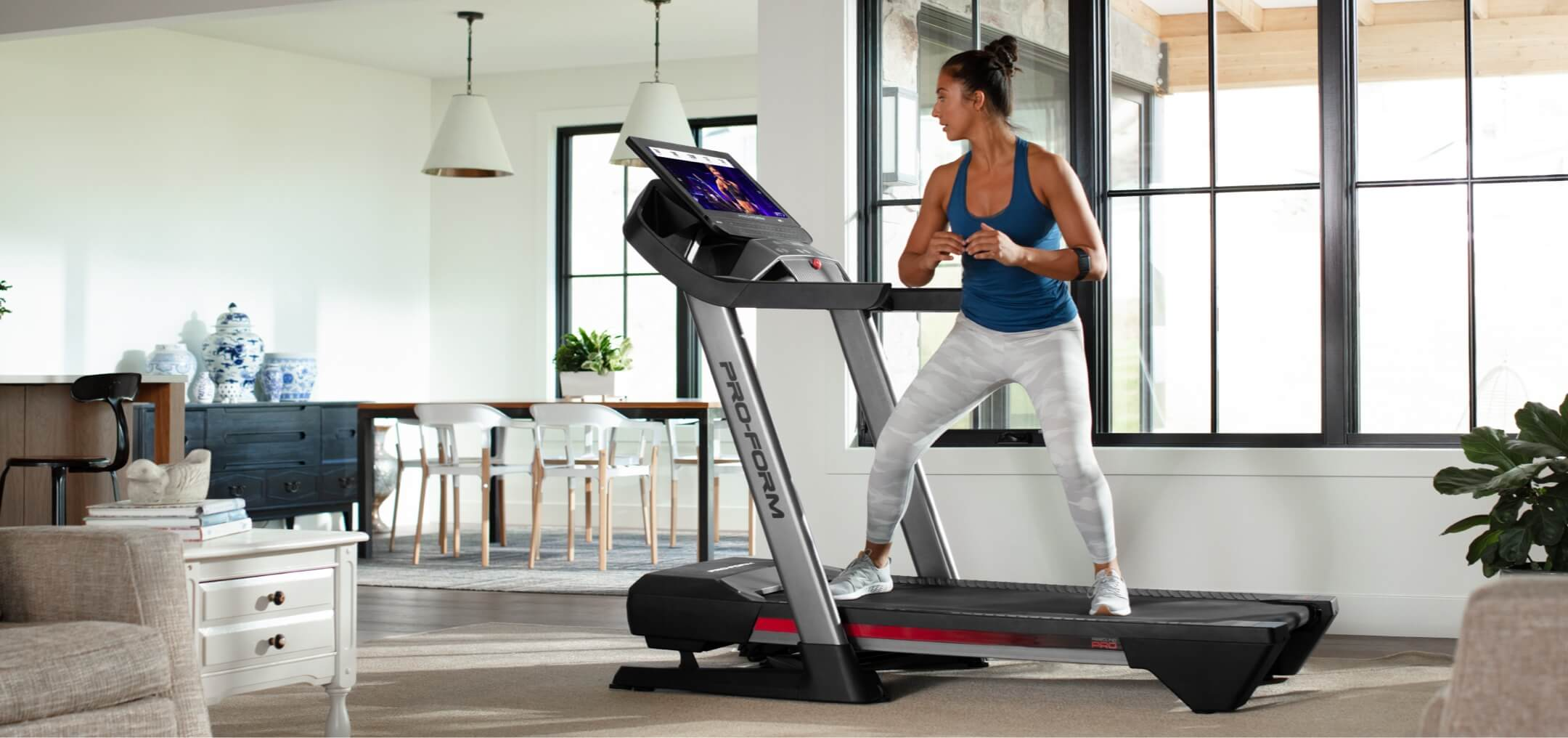 Woman doing a workout on the Pro 9000 treadmill edge.