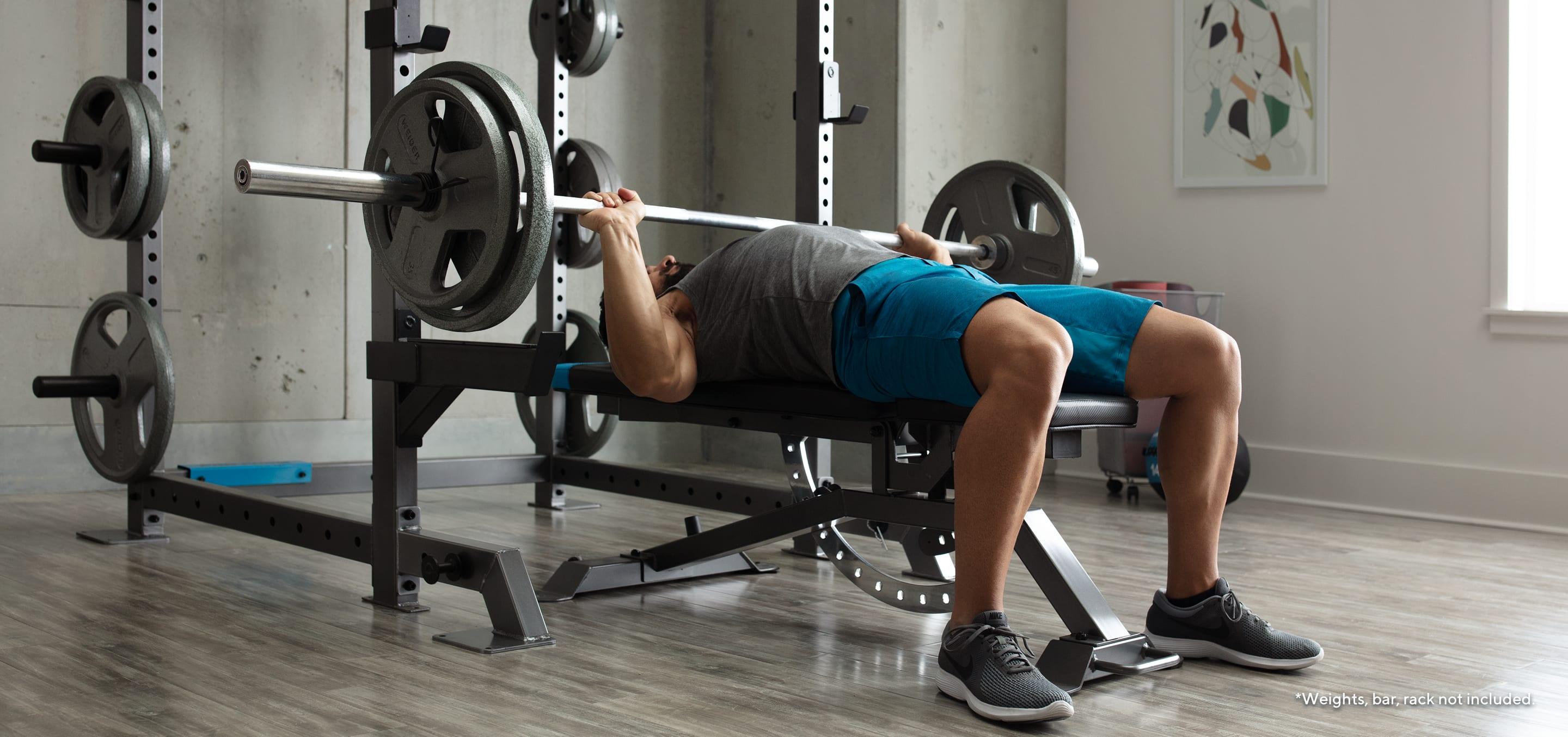 Man doing a bench press (weight, bar, and rack not included).