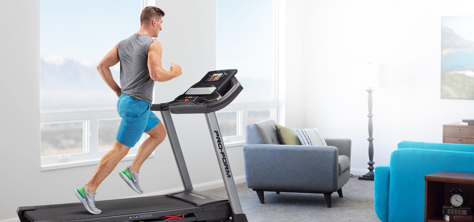 Man running on the Carbon T7 treadmill.