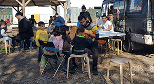 THE GREEK MOBILE LIBRARY MAKING IDRIES SHAH'S BOOKS AVAILABLE TO REFUGEES