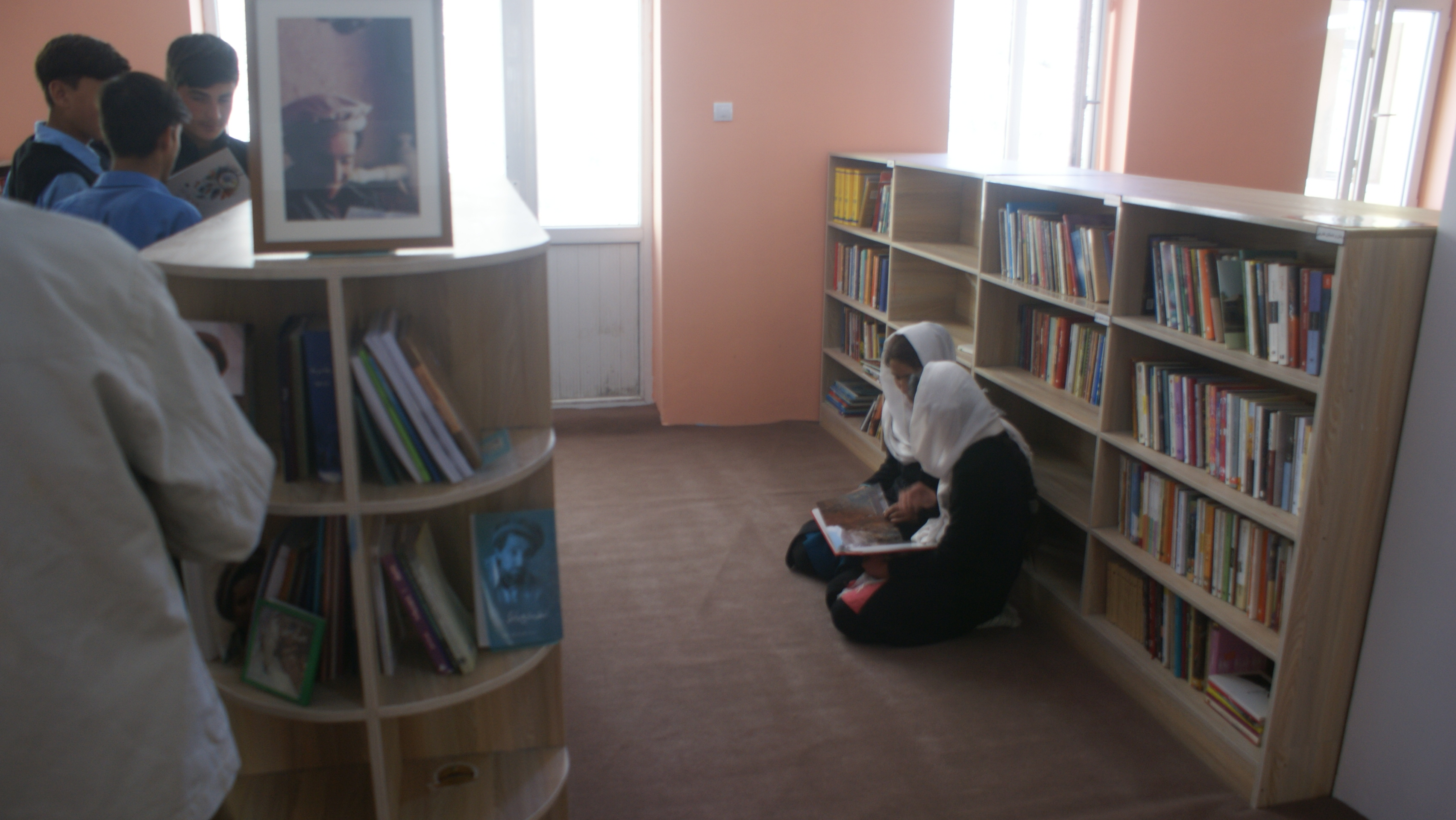 Girls reading on the floor of Afghan library