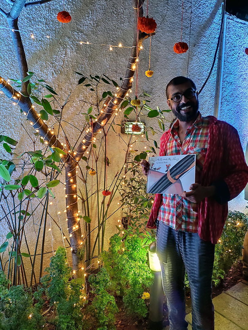 Prashant Miranda receiving the first printed copy of The Ants and The Pen