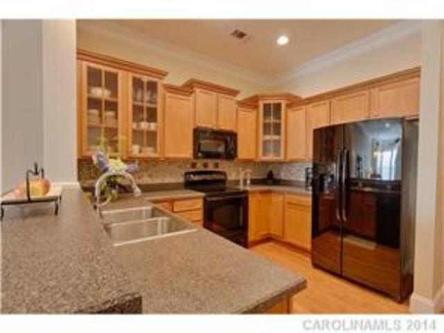 Kitchen features Custom Cabinetry