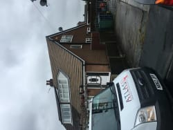 After roof cleaned of moss new uPVC guttering and Downpipe and dry verge installed