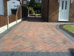 Block paving in brindle with a  charcoal edge
