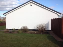 gable wall of teh property in Cumbria after spraying.
