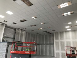 Lay and grid ceiling into jumbo wall