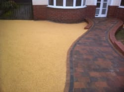 Block paving in brindle with a five mil daltax yellow resin Bond