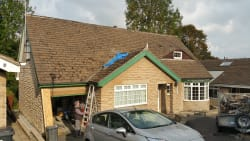 roof before cleaning and nee pvc facias guttering and dry verge systems and new dry valley
