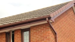 Roosewood fascia, white soffit with a deep flow brown ogee guttering
