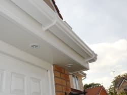 White ogee roofline system with LED spot lights