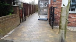 Finished driveway in tobermore tegula trio boarder colour charcoal tegula and main insett is cedar colour