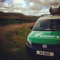 Woody's pest control services  Logo