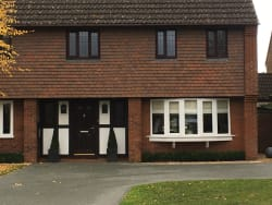 Rosewood on white occupy with white on ground floor all A Rated Rehau